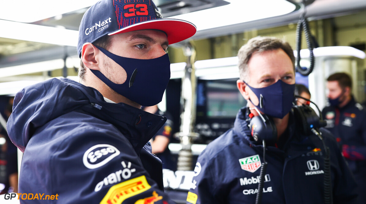 ISTANBUL, TURKEY - OCTOBER 09: Max Verstappen of Netherlands and Red Bull Racing and Red Bull Racing Team Principal Christian Horner look on in the garage during final practice ahead of the F1 Grand Prix of Turkey at Intercity Istanbul Park on October 09, 2021 in Istanbul, Turkey. (Photo by Mark Thompson/Getty Images) // Getty Images / Red Bull Content Pool  // SI202110090158 // Usage for editorial use only //  F1 Grand Prix of Turkey - Final Practice     SI202110090158
