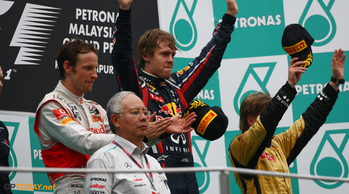 2011 Malaysian Grand Prix - Sunday Sepang, Kuala Lumpur, Malaysia 10th April 2011 Winner, 1st, Sebastian Vettel (GER), Red Bull Racing, 2nd, Jenson Button (GBR), McLaren Mercedes, 3rd, Nick Heidfeld (GER), Lotus Renault GP and Adrian Newey (GBR), Red Bull Racing, Technical Operations Director World Copyright: Andrew Hone / Formula Press / LAT Photographic