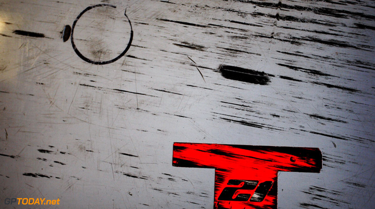 Formula One Testing Tyre marks on the Hispania F1 Racing Team (HRT) garage floor. Formula One Testing, Pirelli Tyre Testing, Yas Marina Circuit, Abu Dhabi, UAE, Friday 19 November 2010.      F1 GP Formula One Formula 1 Abu Dhabi Yas Marina Circuit UAE United Arab Emirates portrait