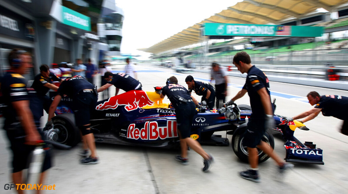 2011 Malaysian Grand Prix - Friday Sepang, Kuala Lumpur, Malaysia 8th April 2011 Sebastian Vettel (GER), Red Bull Racing, pushed back into the garage World Copyright: Andrew Hone / Formula Press / LAT Photographic