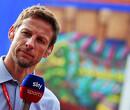 Jenson Button geeft zoontje op de bank schattige eerste rijles