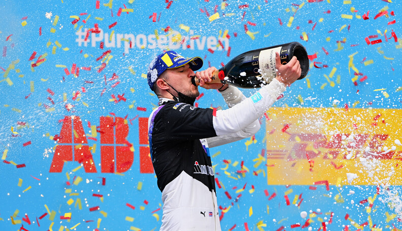 Jake Dennis (GBR), BMW I Andretti Motorsport, 1st position, drinks champagne on the podium  Sam Bagnall Valencia Spain  podium TS-Live Sunday BMW