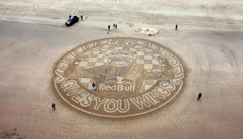 The Dutch Beach Art team creates sand art on Za...